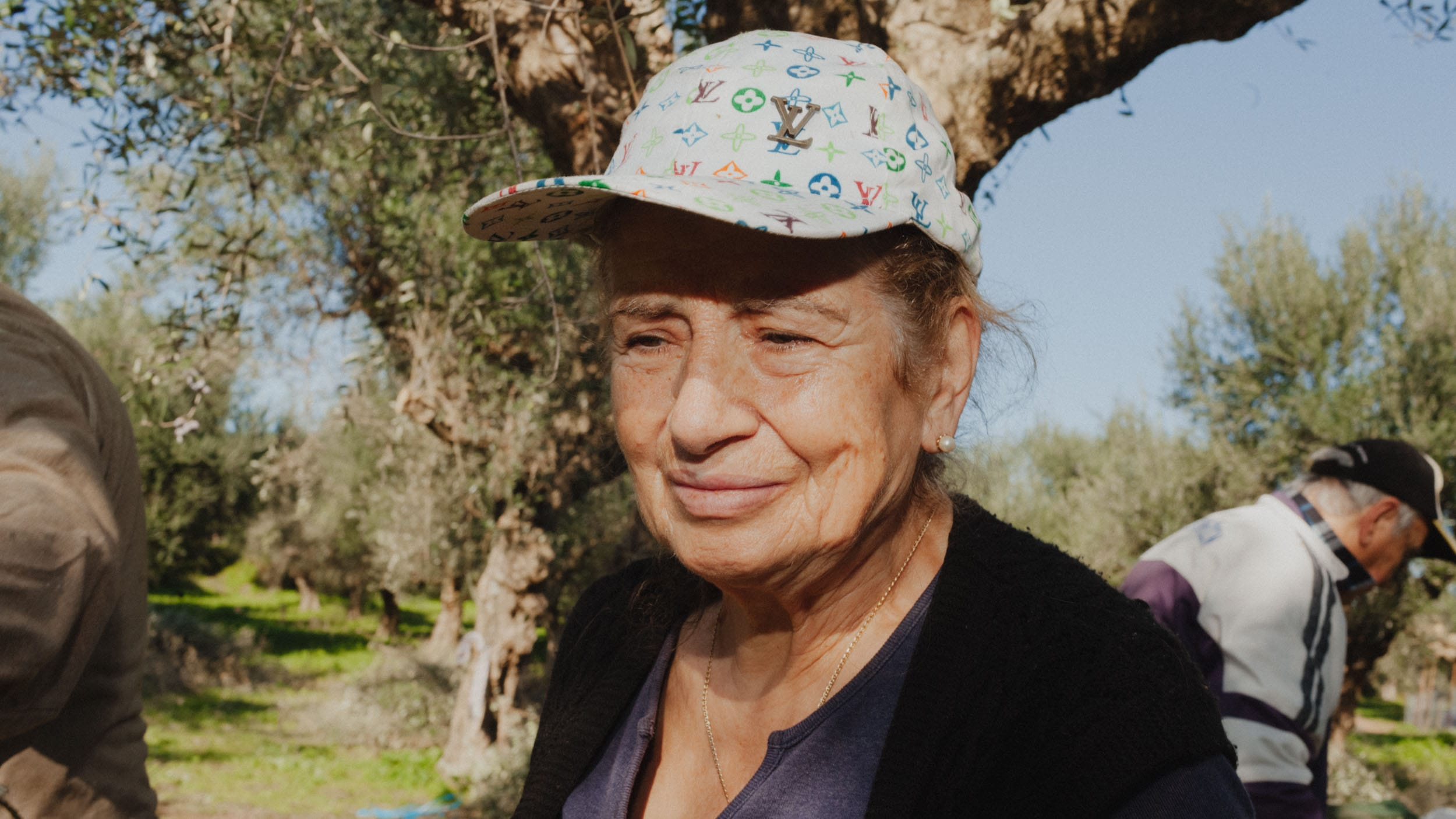 Grandmother Anthoula in the olive grove.