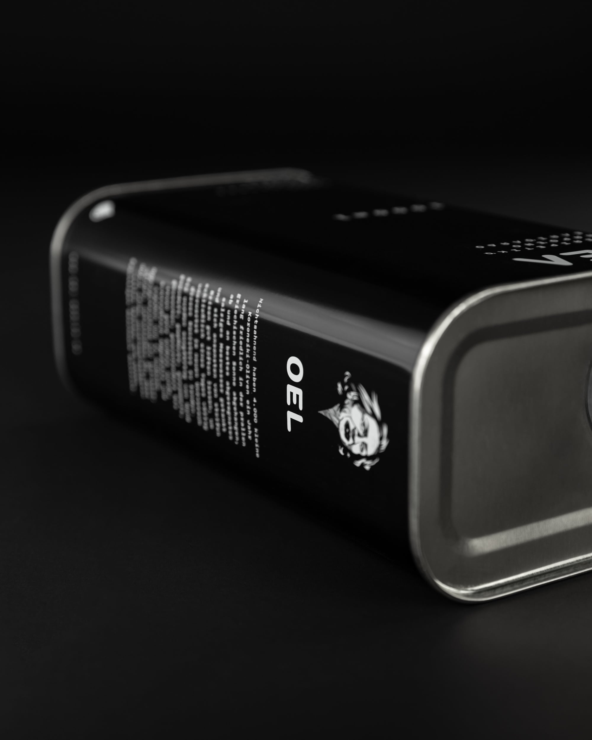 1000ml OEL canister lying on a black background.