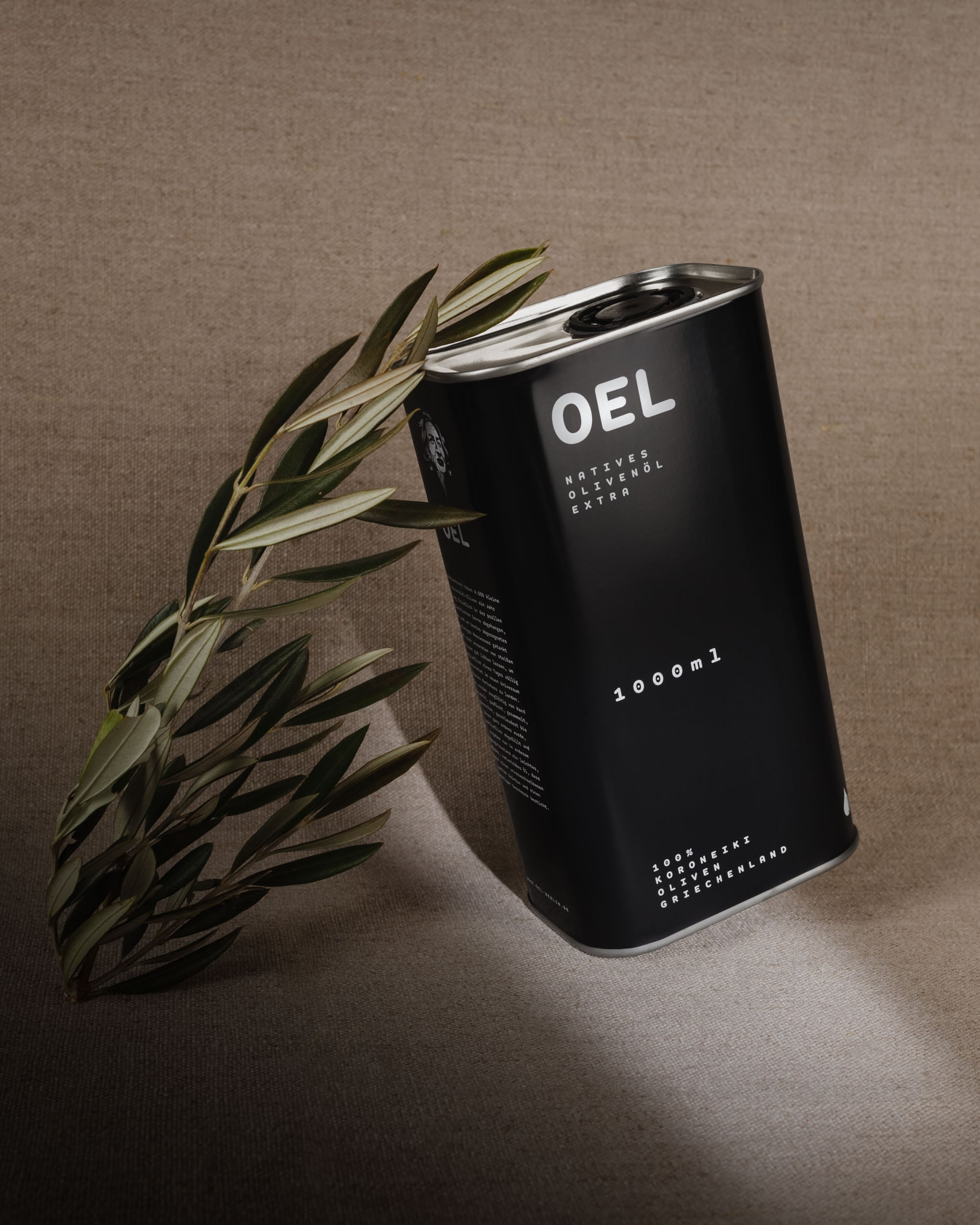 1000ml OEL canister leaning on an olive branch.