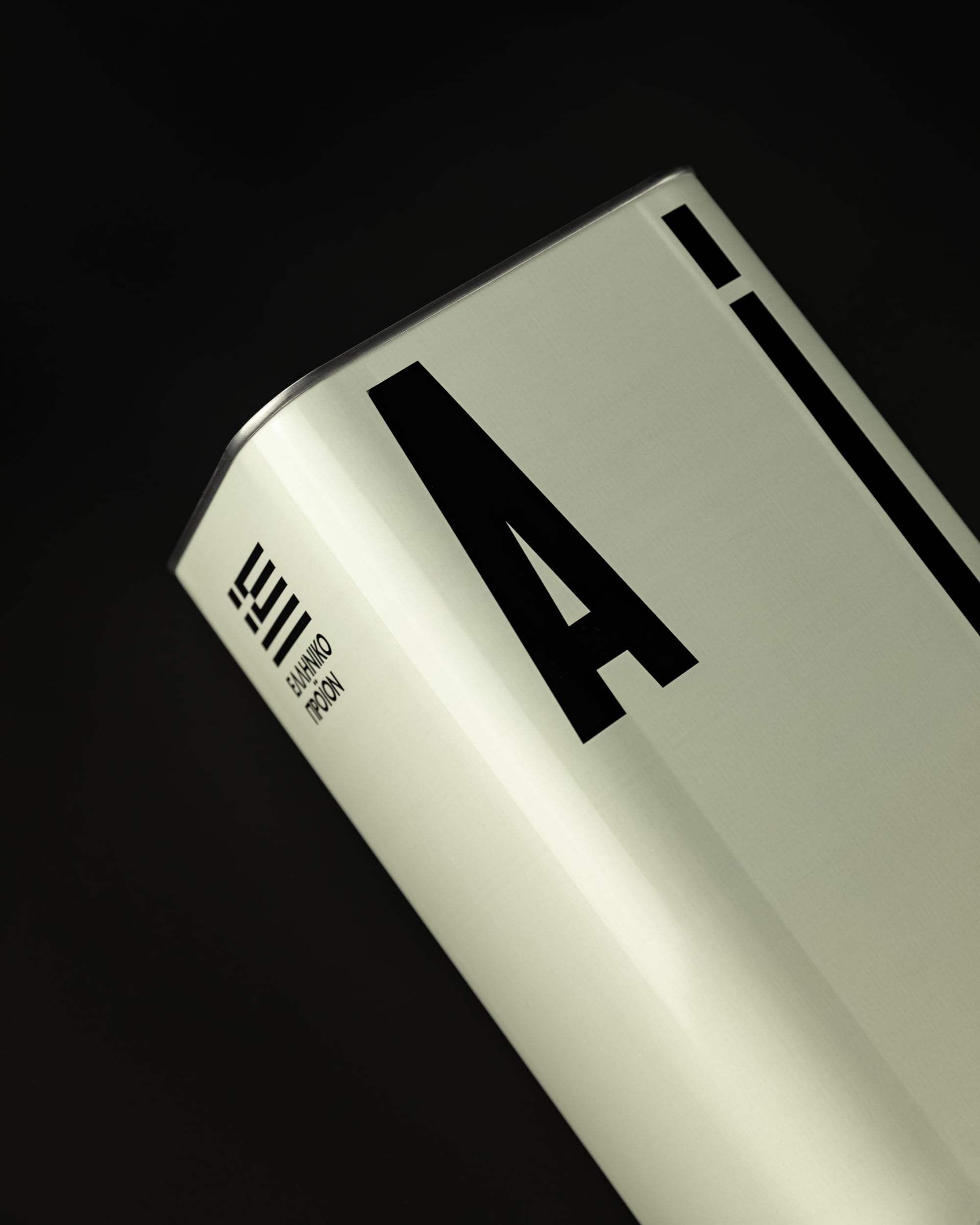 Detail of the 1000ml A! canister against a black background.
